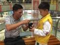娄底举行公益小天使棒棒糖换烟志愿服务活动