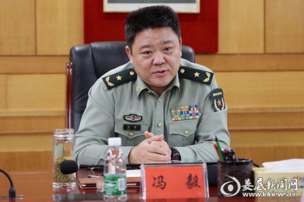 (省委常委、省军区政治委员冯毅)
